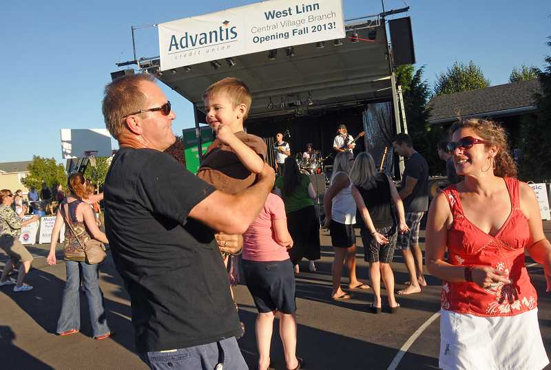 by: TIDINGS PHOTO: VERN UYETAKE - Gary Yarco, left, dances around with James Metson and Ruth Burk to the music of the band Hit Machine during the July 25 Music in the Park concert at Tanner Creek Park.