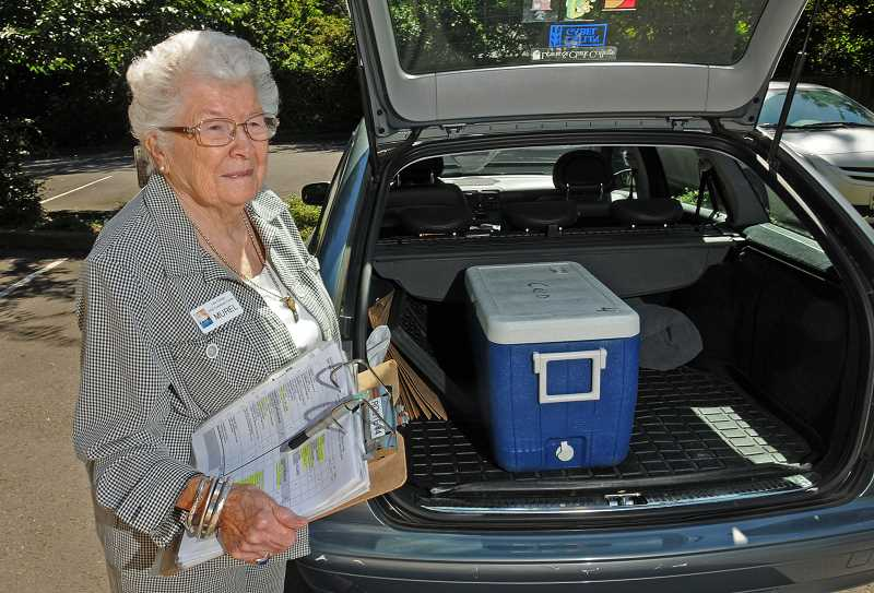 by: VERN UYETAKE - Muriel Johnson gets ready to make a delivery trip for Meals on Wheels in Lake Oswego.