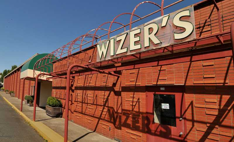 by: VERN UYETAKE - The Wizer block could soon transform into a mixed-used development containing some smaller retail spaces for independent businesses and high-end apartments between First and Second streets, Evergreen Road and A Avenue.