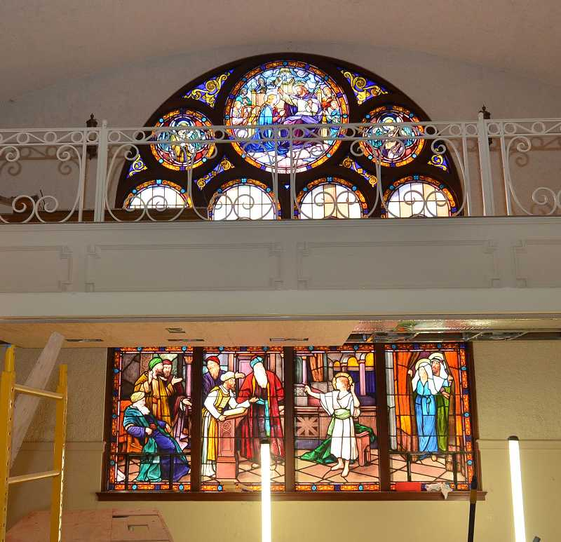 by: REVIEW PHOTO: VERN UYETAKE - The B.P. Administration building features sun-soaked stained glass religious scenes.