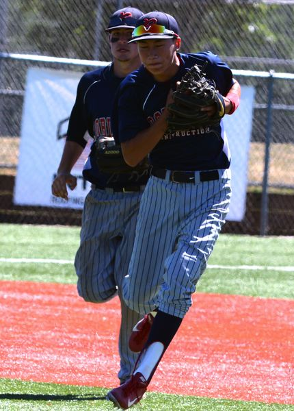by: TIMES PHOTO: MATT SINGLEDECKER - Westview shorstop Taki Ishi fields a top hopper in the OIBA semifinals against Clackamas.