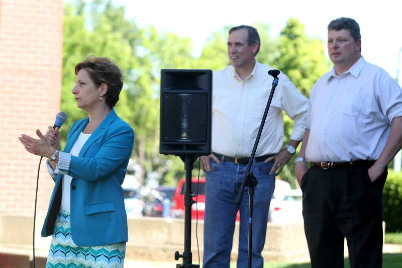 by: TIMES PHOTO: JONATHAN HOUSE - Rep. Susan Bonamici Sen. Jeff Merkly and Councilor Frank Bubenik lcongratulate Tualatin on its centennial at the Tualatin Farmers Market, July 26.