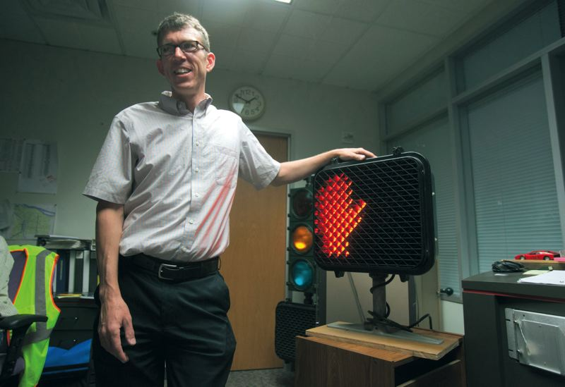 by: TRIBUNE PHOTO: JONATHAN HOUSE - Peter Koonce is in charge of traffic signals for the city of Portland, where all pedestrian signals will have countdowns by the end of 2014.