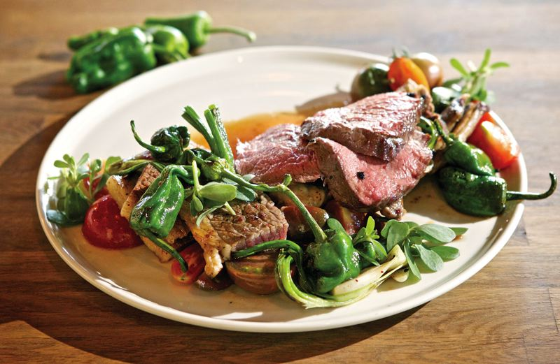 by: TRIBUNE PHOTO: JAIME VALDEZ - Old Salt Marketplace in Northeast Portland freshens up comfort food with seasonal ingredients to create dishes like hearth roasted beef with heirloom tomatoes, padron peppers and onions.