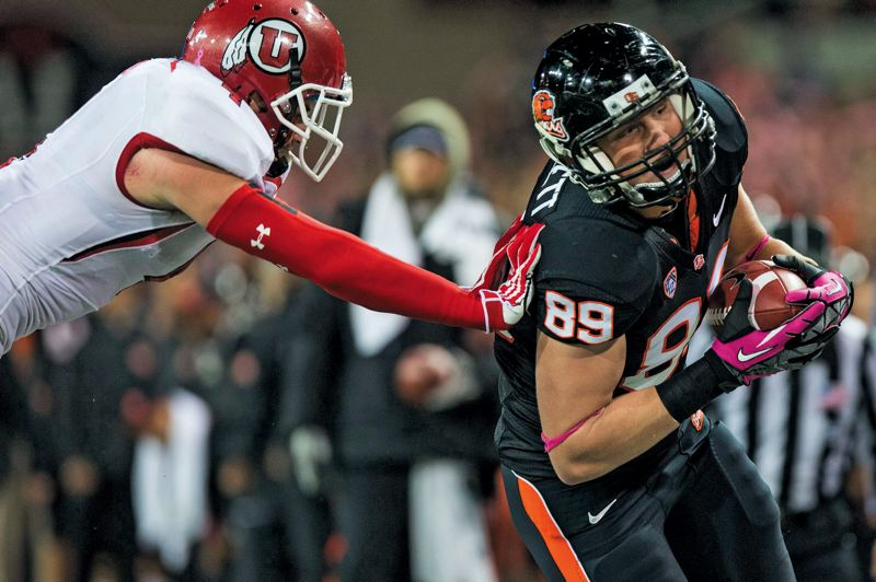 by: TRIBUNE FILE PHOTO: CHRISTOPHER ONSTOTT - Oregon States Connor Hamlett, picking up yardage after a catch against Utah last season, returns at tight end for the Beavers.