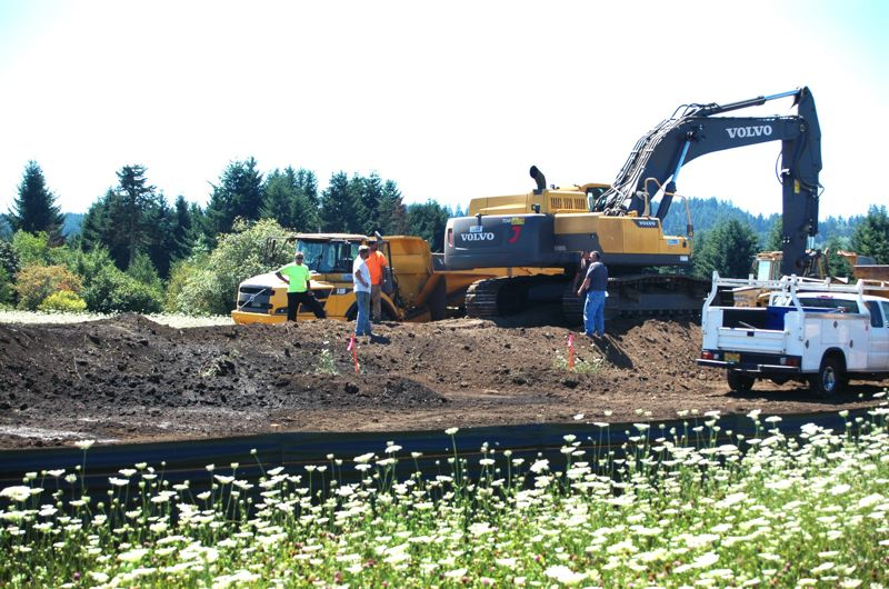 by: ISABEL GAUTSCHI - Developer Michael Park and city leaders hope that the construction of the road will attract large industrial business to Estacada.