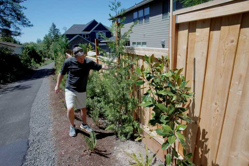 by: TIMES PHOTO: JONATHAN HOUSE - Bill Booth says park district officials didnt listen to local residents' concerns about a buffer zone for their properties, causing them to pay hundres of dollars for privacy fences.