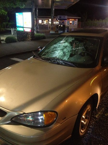 by: COURTESY OF WLPD - West Linn police say a 34-year-old man was seriously injured when he apparently jumped in front of his Pontiac Grand Am late Wednesday night.