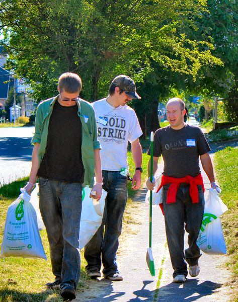 by: JESSI EVEN - Volunteers walked heavily-traveled Woodstock neighborhood streets, picking up litter, during the recent Woodstock Community Cleanup. From left: Safeway employees John Haney, Garrett OMalley, and Marshal Morgan - who volunteered for cleanup duty, and said theyd had fun.