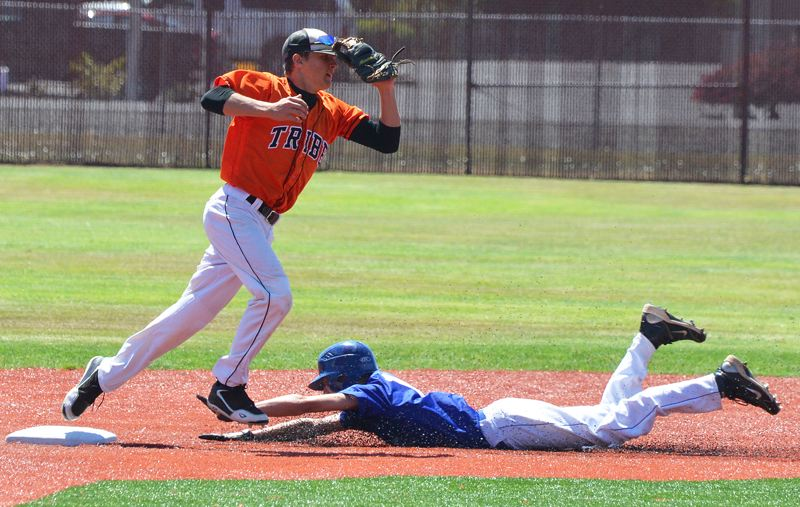 by: JOHN BREWINGTON - Hunter Hoyt touches base for one out and throws to first for a double play during Scappoose Junior State Tournament game with McNary. Scappoose lost this game, beat Dallas, but fell out of the tournament with a loss to Sprague. The Indians won their league with a 15-2 record.