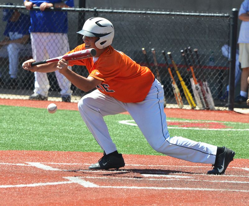 by: JOHN BREWINGTON - Kyler Mizee lays down a bunt during game with McNary at the Junior State Tournament last week.