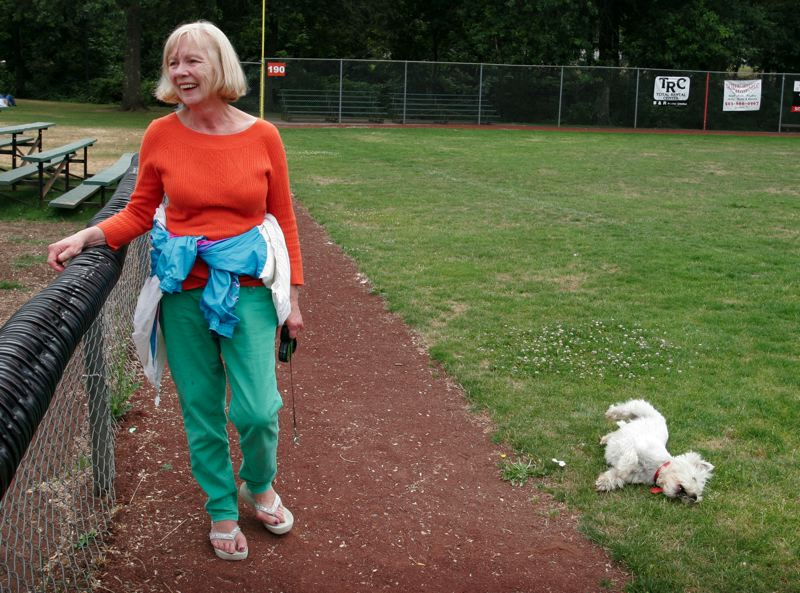 by: OUTLOOK PHOTO: JIM CLARK - Gresham resident Conny Mottram takes her dog Toby to the ball field at Main City Park every day so he can run off-leash. She said plans for an actual off-leash dog park would be a dream come true.