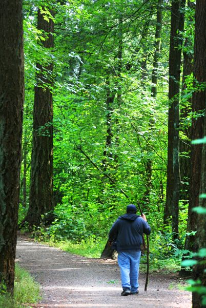 by: OUTLOOK PHOTO: JIM CLARK - Gresham resident Jose Villa walks the loop trail at Nadaka Nature Park on Wednesday, July 31.