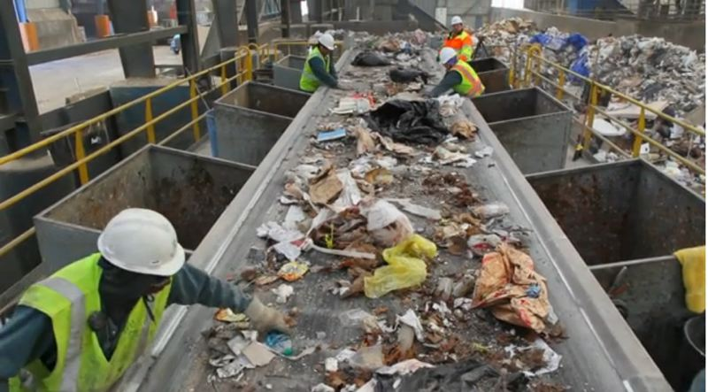 by: PHOTO COURTESY: METRO - In order to recycle as much material as possible, workers sift through trash at Metro South, the regional garbage transfer facility in Oregon City currently celebrating its 30th anniversary and undergoing a two-year review of its services.