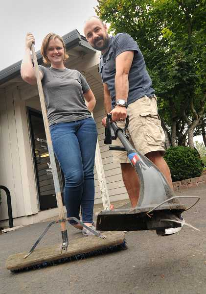 by: PAMPLIN MEDIA GROUP: VERN UYETAKE - Lauren Pickthorn, left, and Milo Curtis are leading the effort to clean up Wilsonville school on August 24
