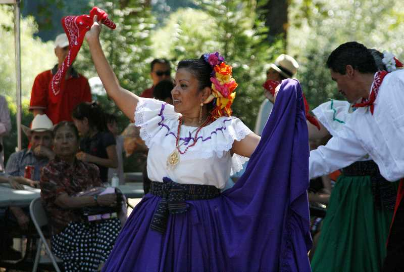 by: PHIL HAWKINS - Rosa Floyd of the local folk dance group Cosecha Mestiza dances with a scarf during a Sunday performance at Fiesta Mexicana.