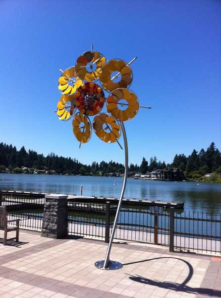 by: REVIEW, TIDINGS  PHOTO: VERN UYETAKE - Sunflower, a kinetic sculpture by Patricia Vader, is on display at Sundeleaf Plaza on State Street.