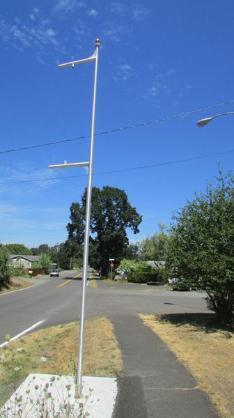 by: MARK MILLER - The pole at the corner of South 11th Street and Old Portland Road in St. Helens is empty after city workers took down the aluminum banner there last month.