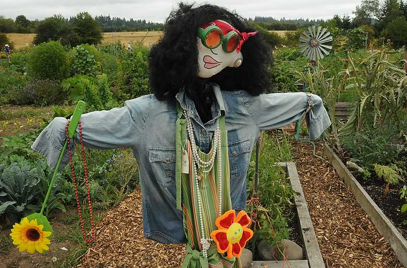 by: VERN UYETAKE - Scarecrow No. 30 has a green thumb.