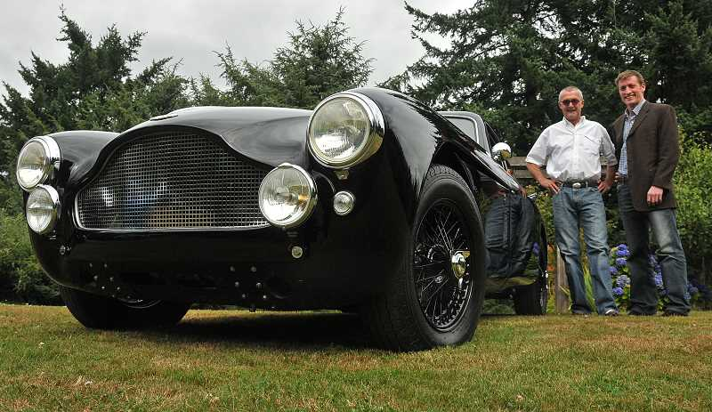 by:  VERN UYETAKE - Dave Adams, 60, and Tanner Halton, 34, pose by their restored 1958 Aston Martin.