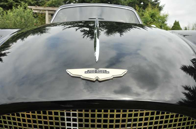 by: VERN UYETAKE - As part of the restoration process, the Aston Martin was repainted a lustrous black.