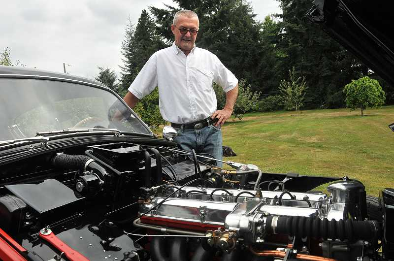 by: VERN UYETAKE - Dave Adams shows off the rebuilt six-cylinder engine of the DB2/4 Mk III.