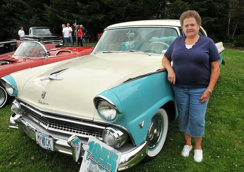 by: VERN UYETAKE - Rose Ek of West Linn stands next to the 1955 Ford Fairlane Victoria she restored with help from her daughter. The car was one of two cars Ek has restored and had at Fridays show.