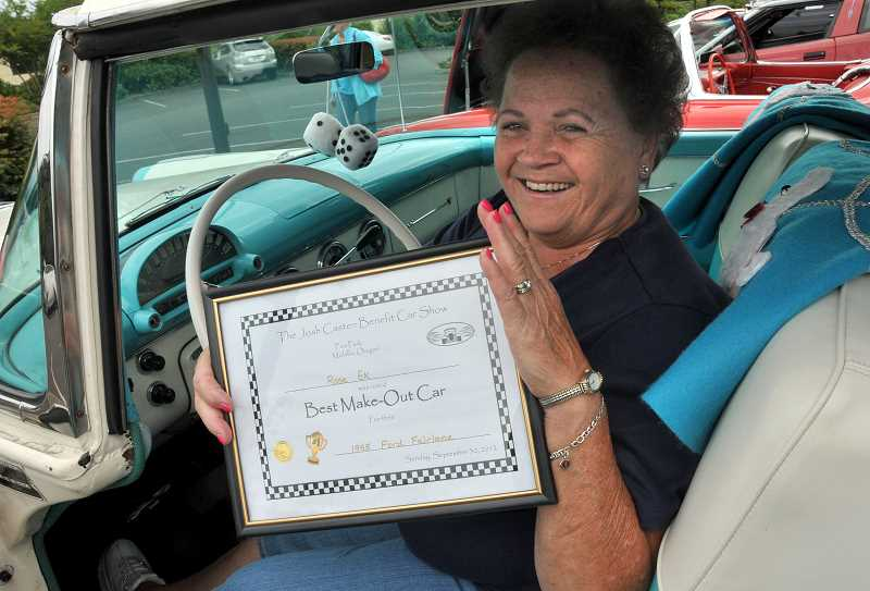by: VERN UYETAKE - Rose Ek proudly displays an award her 1955 Victoria received as the Best Make-Out Car at a previous show.