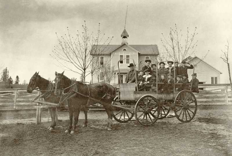 by: SUBMITTED PHOTO: CLACKAMAS COUNTY HISTORICAL SOCIETY - An early school bus sits outside of the first Sunset School, then known as West Oregon City School, in 1904.