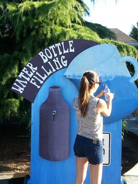 by: SUBMITTED PHOTO - The water bottle filling station has been popular at events like the Old Time Fair and the West Linn Street Dance.