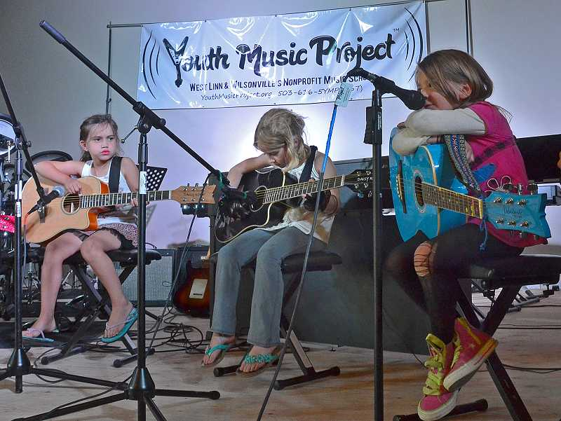 by: PAMPLIN MEDIA GROUP: VERN UYETAKE - From left, Wilsonville's Madison Talarico, Lake Oswego's Taylor Forseth and West Linn's Lilly Randolph performed together at YMP on July 26.