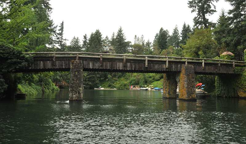 by: VERN UYETAKE - This historic bridge designed by Richard Sundeleaf is one of the Jantzen estate's defining historical features and is considered a city historic landmark.