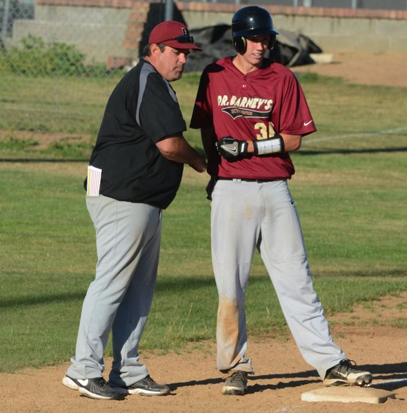 by: TIMES PHOTO: MATT SINGLEDECKER - Former Southridge baseball coach Joe Monahan, seen here with David Knudsen during OIBA action, took the head coaching job at West Linn on Friday.