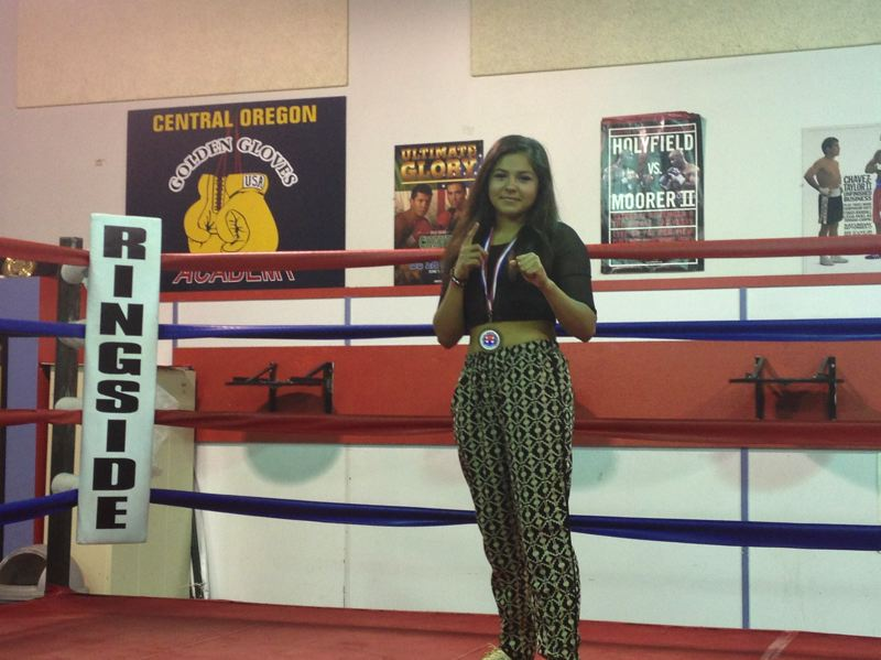 by: COURTESY PHOTO: JOCELYN TAYLOR - Angie Ornelas took third in the Junior Olympics in June after going through a rigorous training regimen with the Beaverton Police Activities League boxing program.