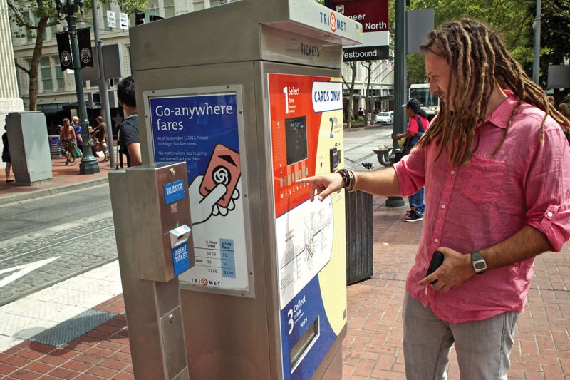 by: TIMES PHOTO: JAIME VALDEZ - TriMet hopes that giving riders more options for buying fares will reduce the use of its problem-prone vending machines, like this one in downtown Portland.