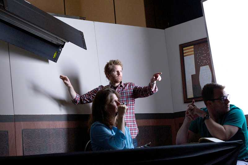 by: TIMES PHOTO: JAIME VALDEZ - Jesuit High School graduate Alex Buono, director of photography on the Saturday Night Live film unit, demonstrates how to light a scene during an all-day seminar at the Embassy Suites Portland Airport.