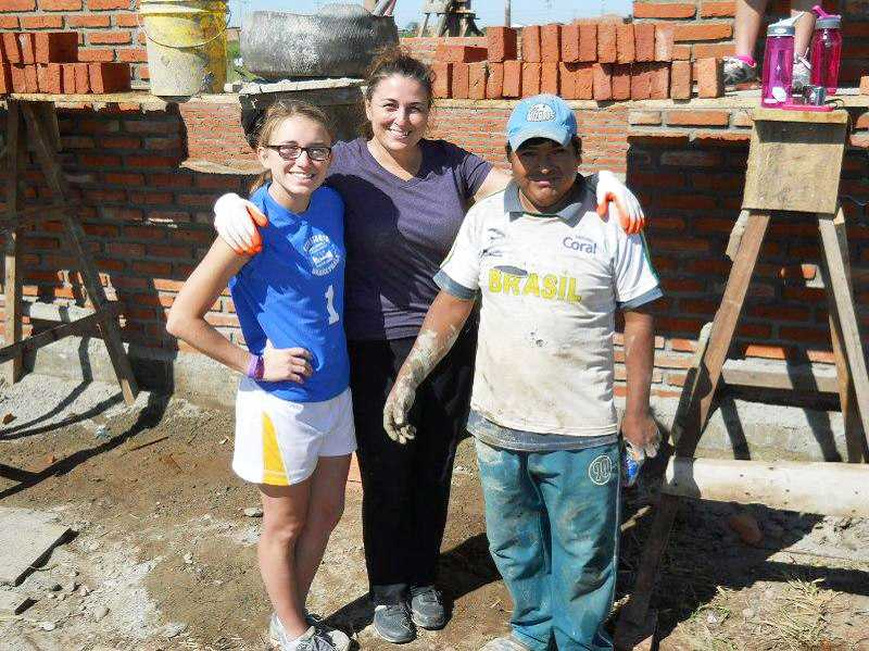 by: SUBMITTED PHOTO - Sydney Cottle and her mother, Michelle Cottle, labored alongside many locals while building a school in Bolivia.