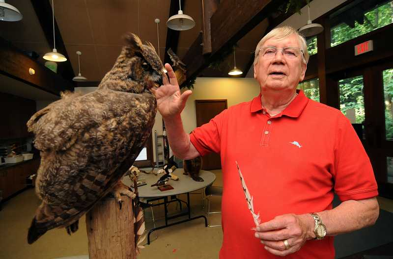 by: REVIEW PHOTO: VERN UYETAKE - Volunteer nature guide Bob Snyder displays the educational offerings in the Tryon Creek State Natural Area Nature Centers classroom.