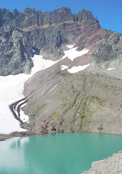 by: PHOTO BY SCOTT STAATS - A lake forms at the bottom of a glacier on Three Fingered Jack.