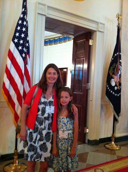 by: SUBMITTED PHOTO - Audrey Russell and her mother, Laura Russell, were invited to the Kids State Dinner at the White House, where they met President Barack Obama and Michelle Obama, the first lady.