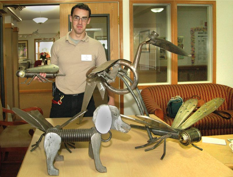 by: ISABEL GAUTSCHI  - Grace House maintenance man Argie Prath shows off some of his metal creations.