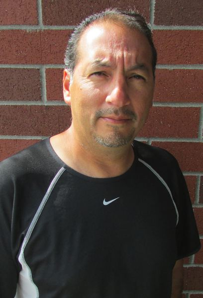 by: JOHN HOWARD - Oscar Monteblanco, St. Helens boys soccer coach
