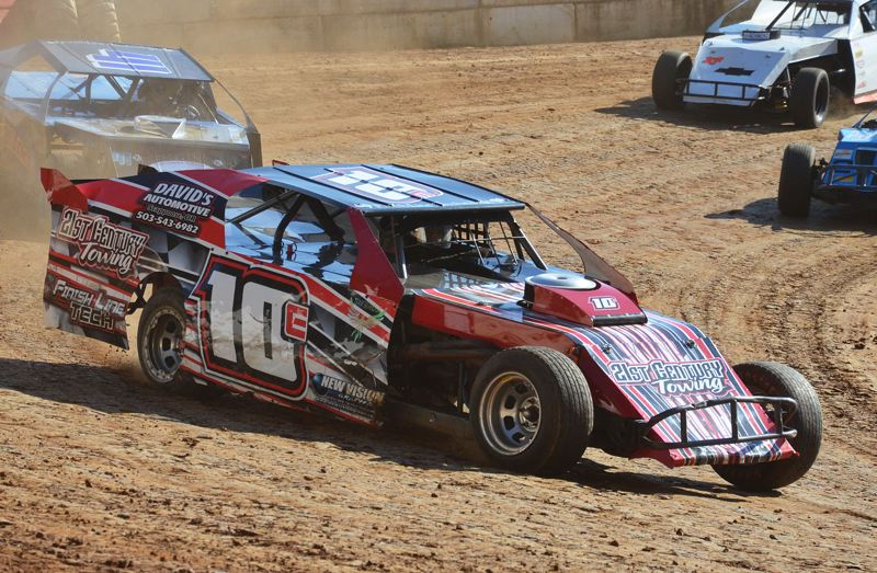 by: JOHN BREWINGTON  - Clark Tenny leads (and won) his heat in the Modified Division at River City Speedway on Saturday night. Tenny also won the main event and leads in the division points race.