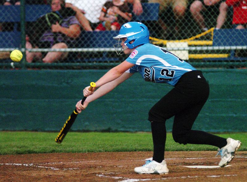 by: DAN BROOD - FUNDAMENTALS -- Tualatin City's Kendra Gooding puts down a successful sacrifice bunt in the third inning of Friday's game at the Little League Softball World Series.