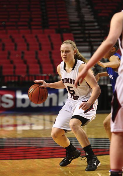 by: PHOTO COURTESY OF NORTHWEST SPORTS PHOTOGRAPHY - Glencoe guard Kaylie Van Loo dribbles upcourt in a mostly empty Rose Garden during a consolation bracket game at the 2012 state basketball tournament.
