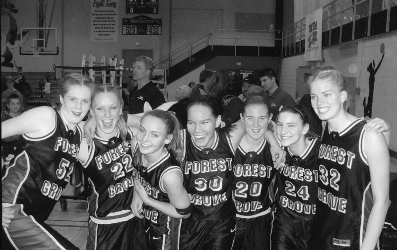 by: COURTESY PHOTO - Rachel Aina (30) celebrates with her Forest Grove basketball teammates after a game in 2005. Aina will be inducted into the school's athletic Hall of Fame later this year.