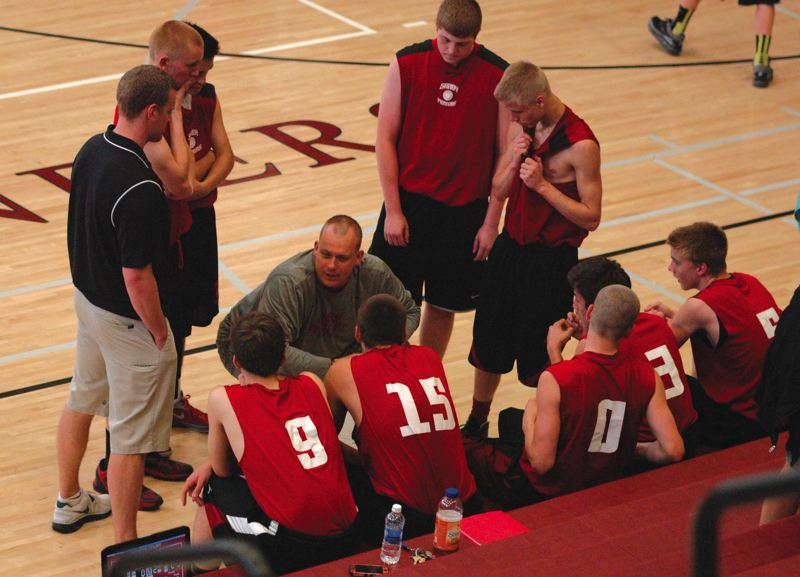 by: FILE PHOTO - Head basketball coach Jason Maki talks to his team during a timeout last winter.