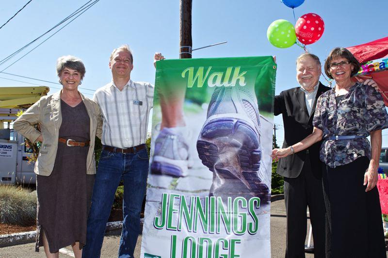 by: PHOTO BY: JAIME VALDEZ - Metro Councilor Carlotta Collette (from left), Clackamas County Commissioner Paul Savas, MAP-IT Chairman Ed Gronke and Jennifer Harding, vice-chairwoman, unveil banners last week in Jennings Lodge.