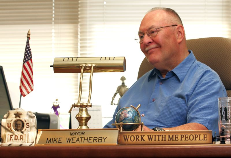 by: OUTLOOK PHOTO: JIM CLARK - At his office in City Hall, Fairview Mayor Mike Weatherby speaks about receiving the Mayors Leadership Award from the Oregon Mayors Association.