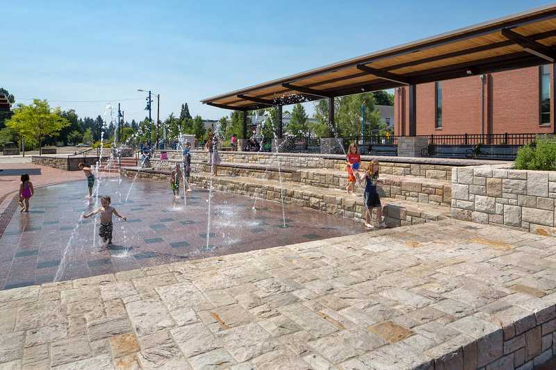 by: FILE PHOTO COURTESY OF JOSH PARTEE - Kids play in the Cannery Square fountain last year. Sherwood was recently named the fifth best city to live by CNN Money magazine for a city with a population between 10,000 and 50,000 residents.
